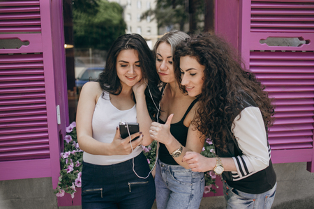 sit around: Girls walking around town, sit in cafes and pictures on phones
