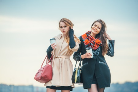 Two pretty girls walking in the city Stock Photo