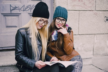 stylishly: two beautiful girls walk around town fashionably and stylishly dressed Stock Photo