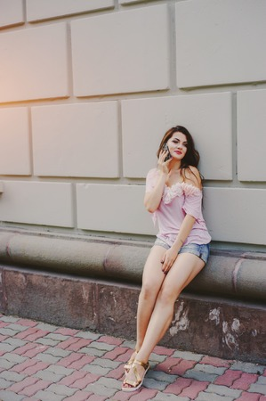 Girl does a make-up, walks in the park and photographed Stock Photo