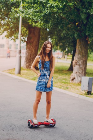 Beautiful girl is walking around the city and admire good location Stock Photo