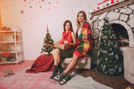 coverlet: Girl decorate the Christmas tree. give gifts. pictures. good time Stock Photo