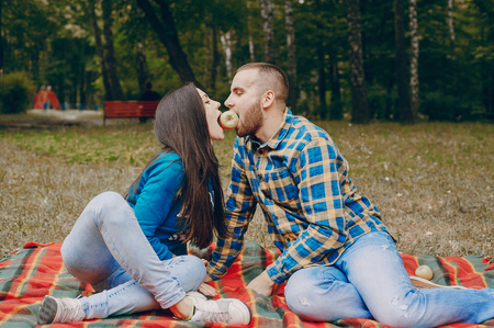 coverlet: young couple relaxing in the park sitting on coverlet