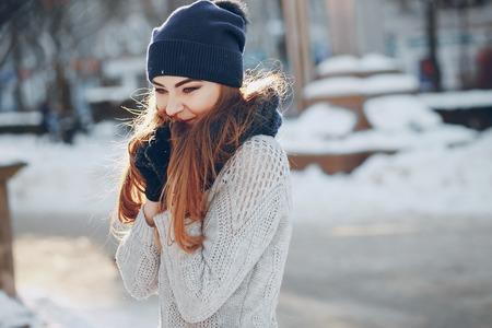 girl walking in a winter city