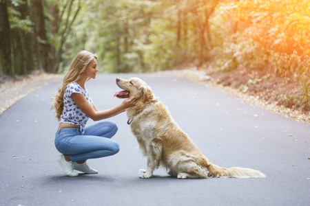 couple walking outdoors with her dog