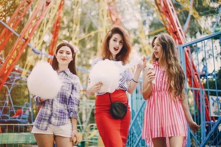Three girls on a walk Фото со стока
