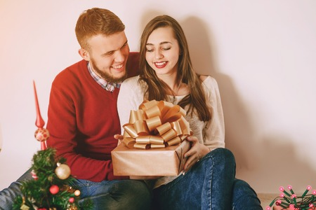 decorating: loving couple decorating Christmas tree Stock Photo