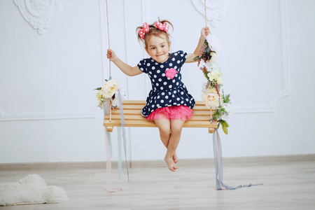 adorable little girl on a swing 스톡 콘텐츠