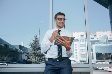 businessman with a tablet working outside