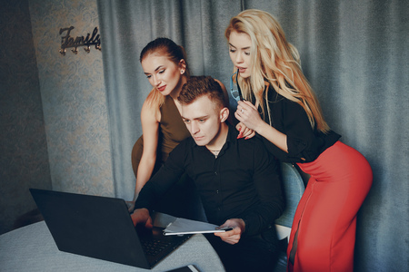 three beautiful business people having discussion