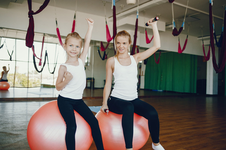 Mother with daughter in a gym