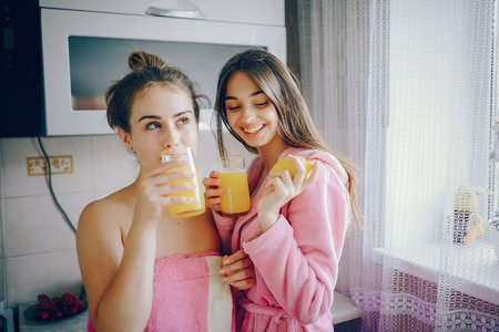 Girls with orange juice