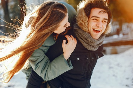 Loving couple walking in a winter park Stock Photo