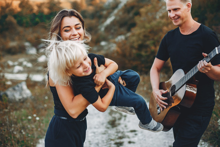 Stylish family in a park
