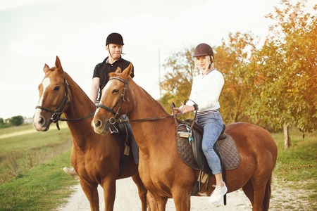 couple with horses Stock Photo
