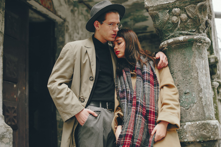 A trendy couple in a gloomy city