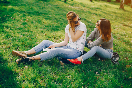 two girls in a summer park Фото со стока