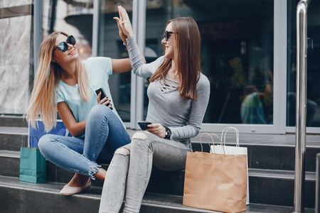 Cute girls with shopping bag in a city Stock fotó