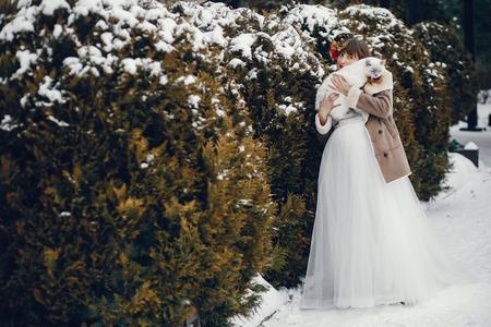 Elegant woman in a long white dress Stock Photo