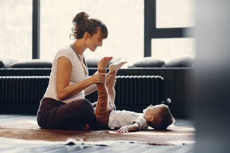 Mother with little son doing yoga at home 스톡 콘텐츠 - 121839100
