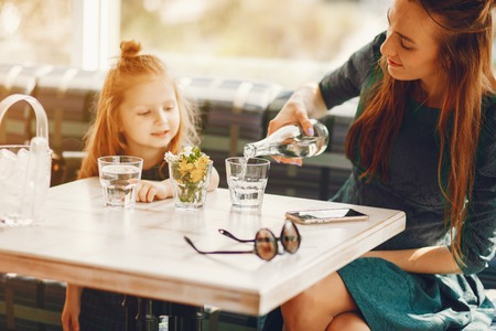 stylish mother with daughter Stock Photo - 121841733