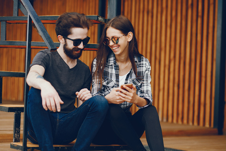 Couple sitting with phone