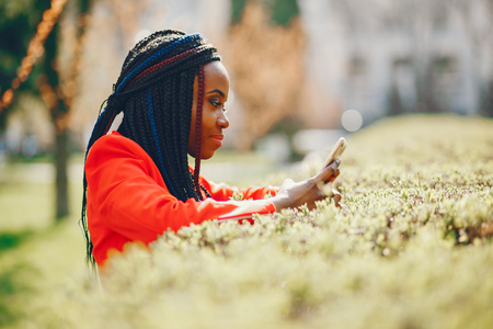 Black woman in a park