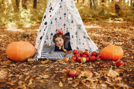 Cute little girl in a autumn park