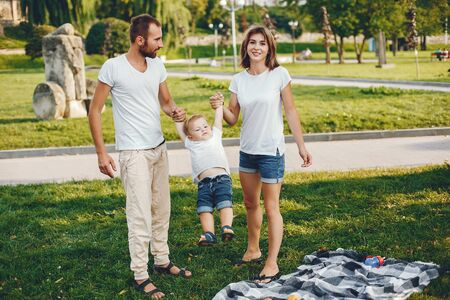 Family with son playing in a summer park Stock Photo