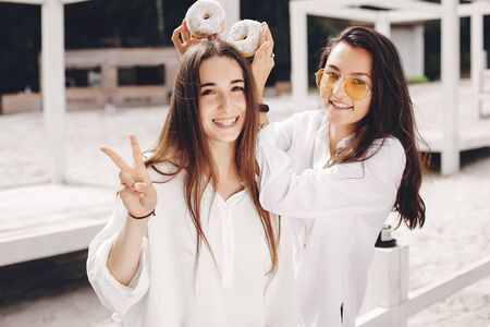 Two pretty girls in a summer park Stock Photo