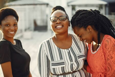 Beautiful black girls standing in a sumer park Stock Photo