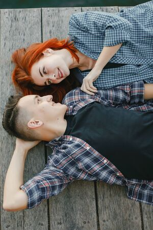 Beautiful couple spend time near a water