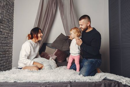 Father and mother with little daughter