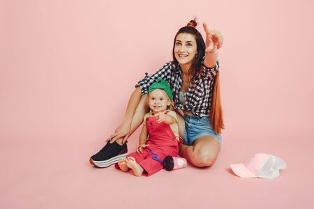 Mother and daughter have fun in a studio