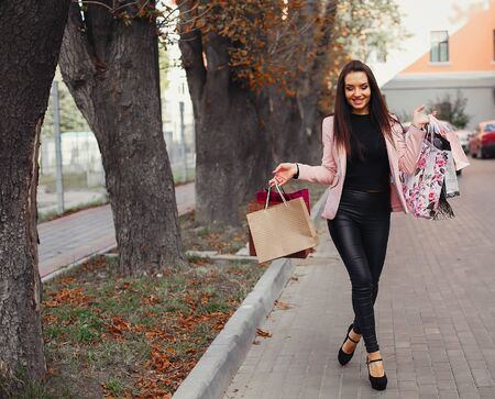 Woman with shopping bag in a city Stok Fotoğraf