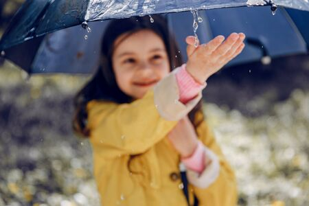 Cute kid plaiyng on a rainy day