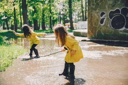 Cute kids plaiyng on a rainy day