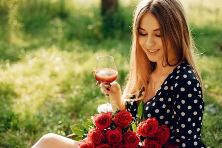 Elegant and stylish girl in a summer garden 스톡 콘텐츠 - 128870766