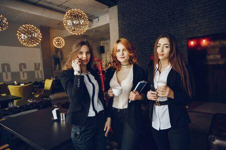 three businesswomen in a cafe Stok Fotoğraf