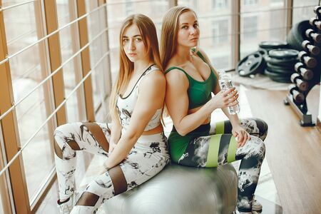 two sporty girls in a gym Stock Photo