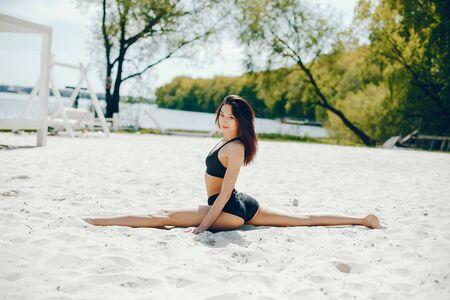 Sport girl on a beach Stock Photo - 129820459