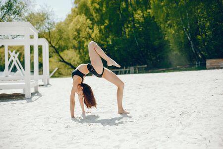 Sport girl on a beach Stock Photo - 129820485
