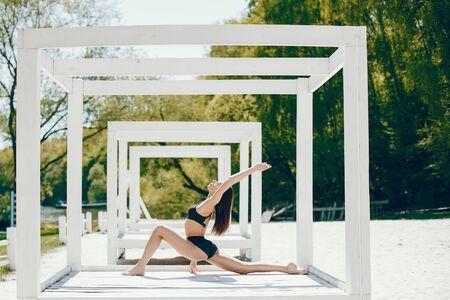 Sport girl on a beach Stock Photo - 129820890