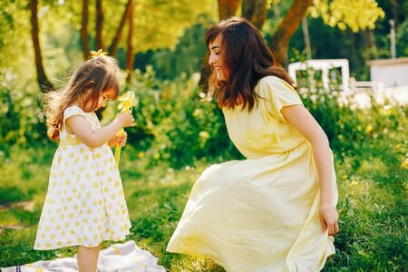 mother with daughter in a solar park