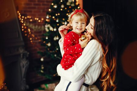 Mother with cute daughter at home