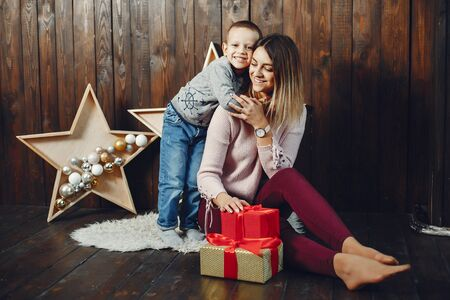 Mother with cute son in a photo studio Stock fotó