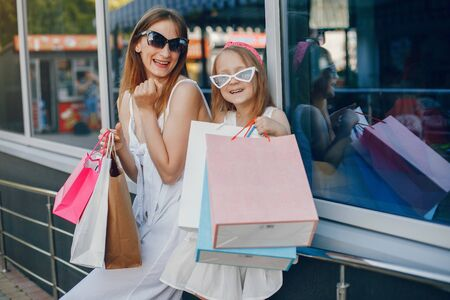 Mother and daughter with shopping bag in a city Stock fotó