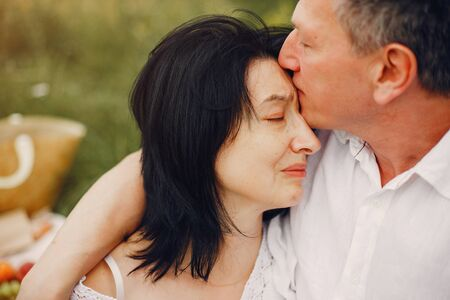 Beautiful adult couple spend time in a summer field Stockfoto