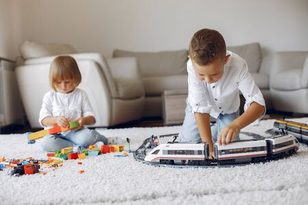 Children playing  and toy train in a playing room Zdjęcie Seryjne