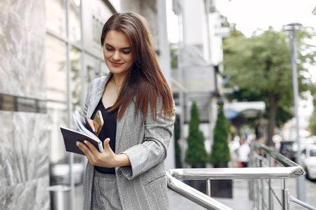 Elegant businesswoman working in a city and use the notebook Reklamní fotografie